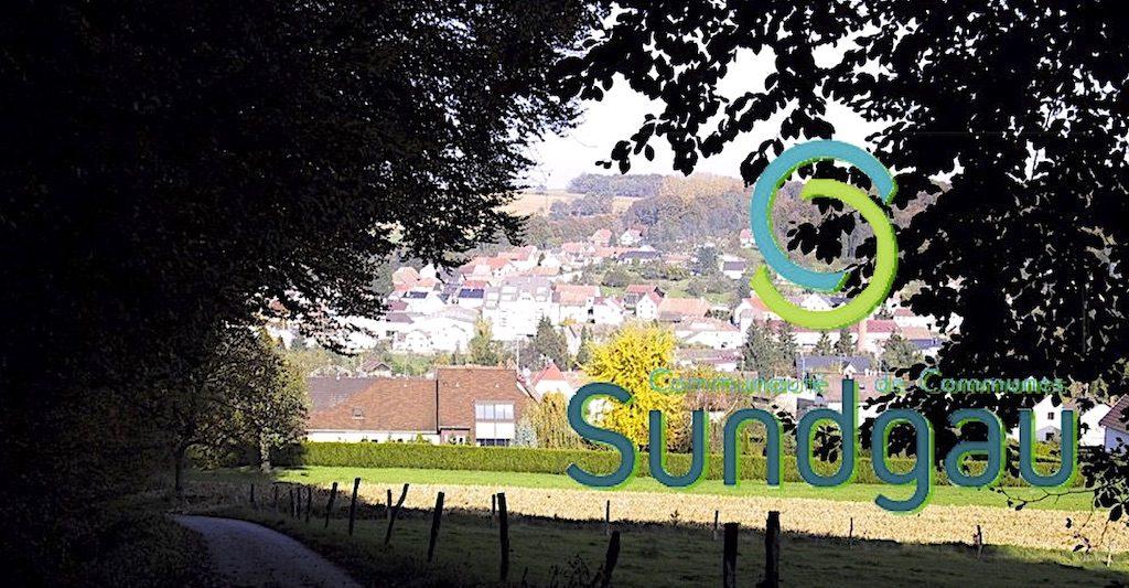 Bandeau Com Com Sundgau sur une photo de Waldighoffen